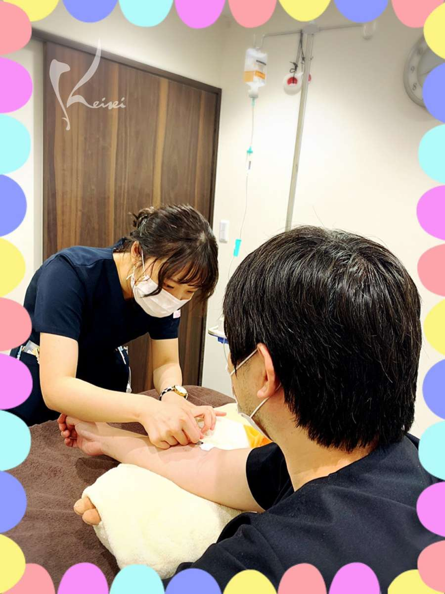 高濃度メガビタミンC点滴を受ける菅野先生の画像